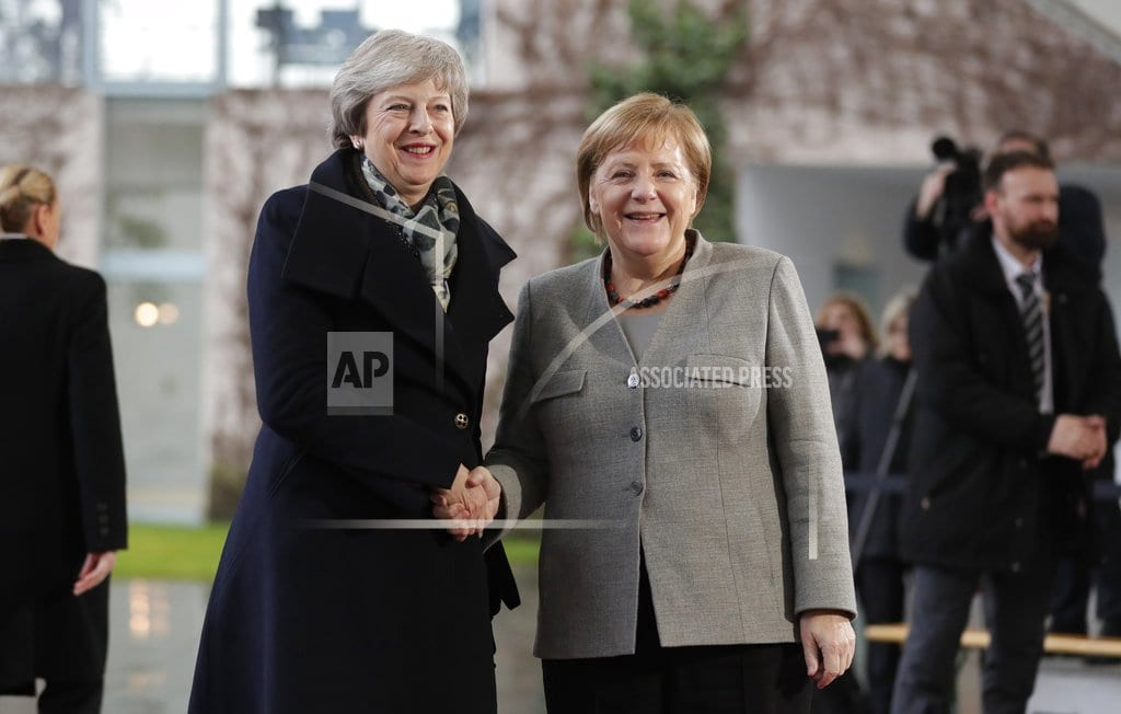 THE HAGUE, Netherlands  | The Latest: May says UK, EU have 'shared determination'