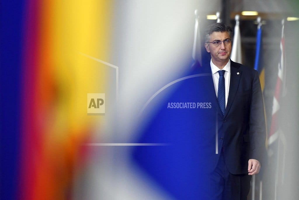 BRUSSELS | The Latest: Romania seeks to encourage British leader