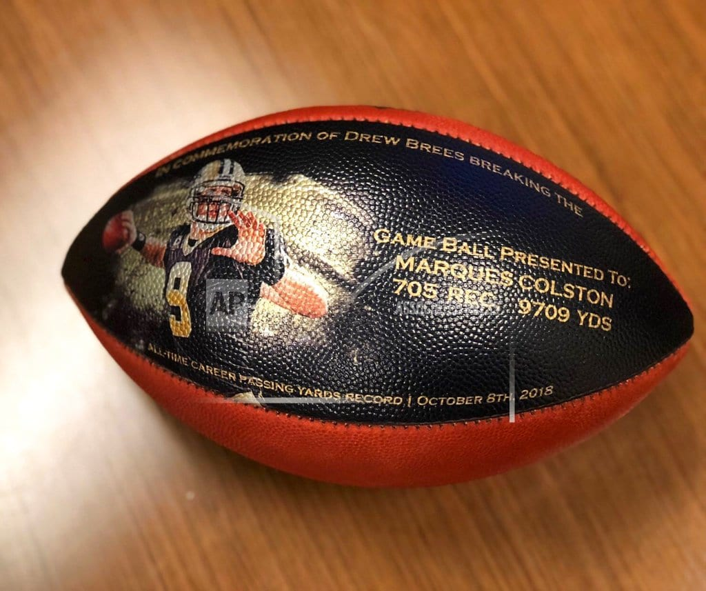 METAIRIE, La. | Gift from Brees: Football for helping set NFL passing record