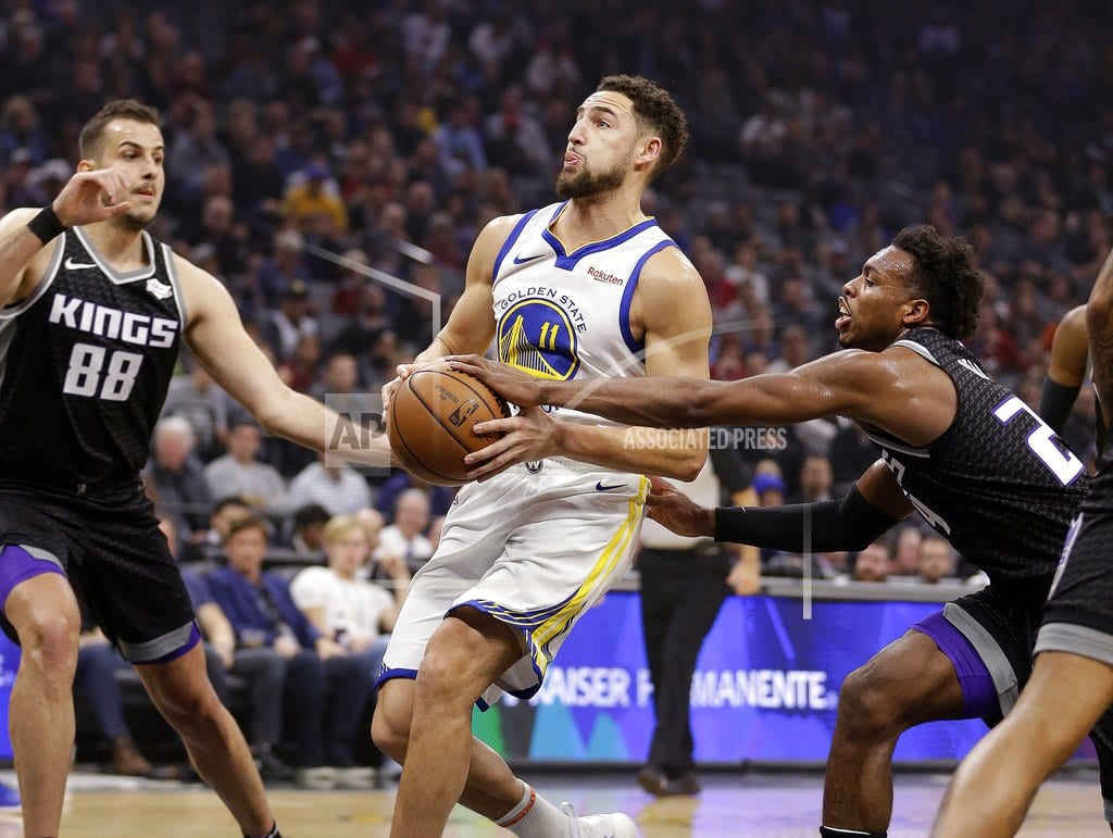 SACRAMENTO, Calif  | Curry, Thompson help Warriors beat Kings 130-125