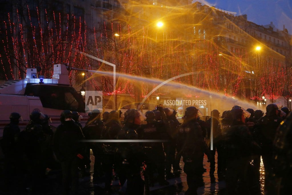 PARIS  | Tear gas in Paris, but fewer protesters and bigger demands