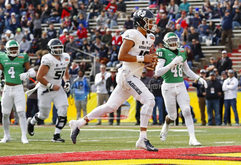ALBUQUERQUE, N.M | Utah State routs North Texas 52-13 in New Mexico Bowl