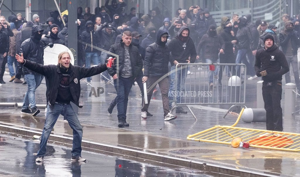 BRUSSELS | Police, anti-migration protesters clash at EU headquarters
