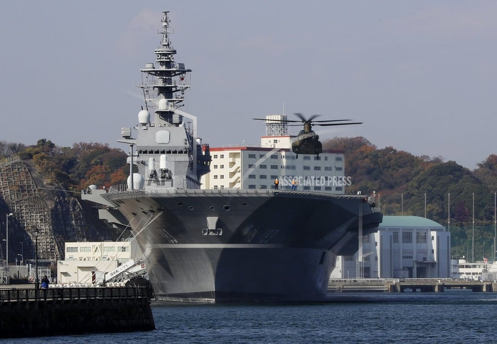 TOKYO | Japan to spend more on defense, refit 1st aircraft carrier