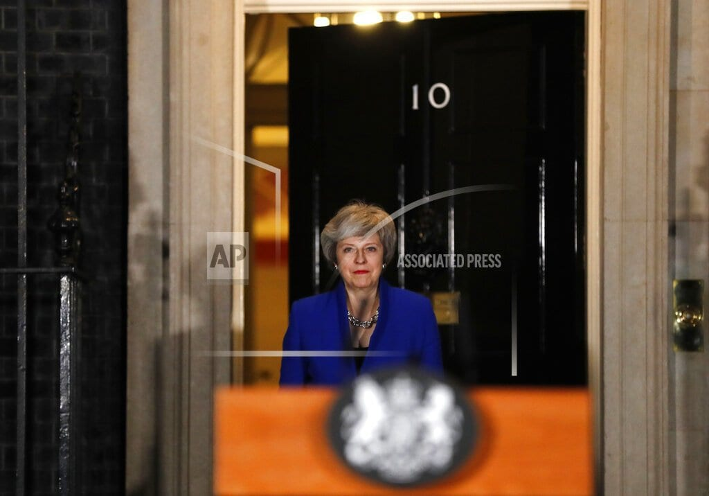 LONDON | May battles to keep Brexit on track after no-confidence win