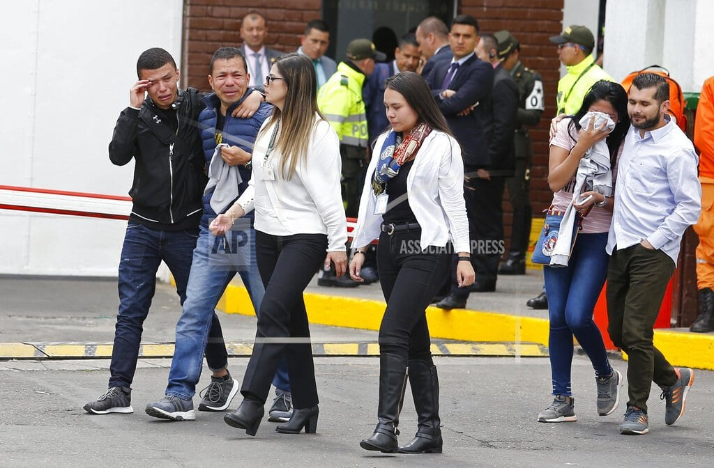 BOGOTA, Colombia | Death toll in Colombia bombing rises to 21 as threats linger
