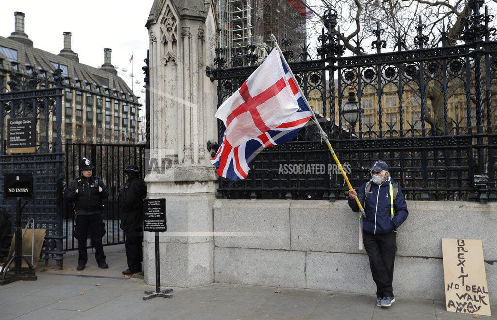 LONDON | The Latest: UK to scrap application fee for EU citizens