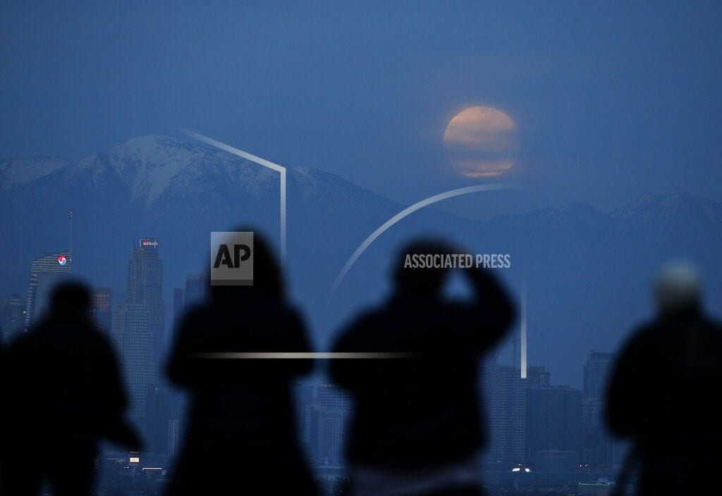 CAPE CANAVERAL, Fla   2-for-1: Total lunar eclipse comes with supermoon bonus