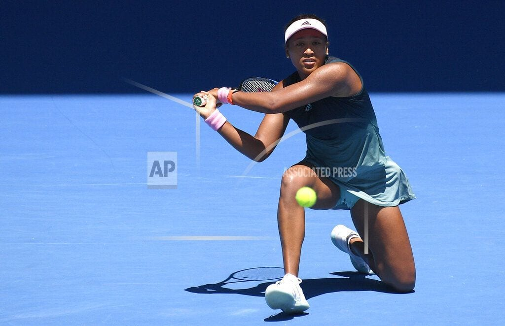 MELBOURNE, Australia   The Latest: Wig and sunglasses, Osaka goes in disguise