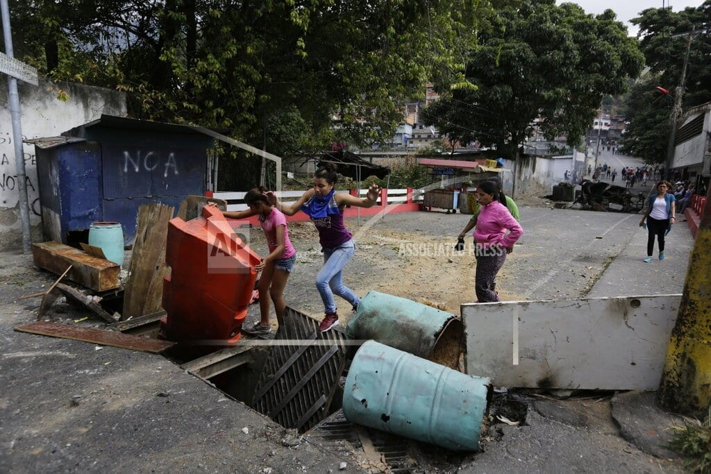 CARACAS, Venezuela | The Latest: Maduro fires back at US after criticism by Pence