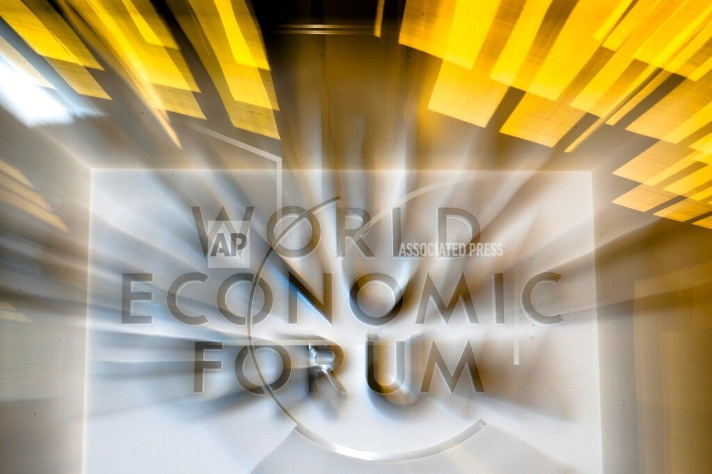 DAVOS, Switzerland | The Latest: Retraining workers could help US government