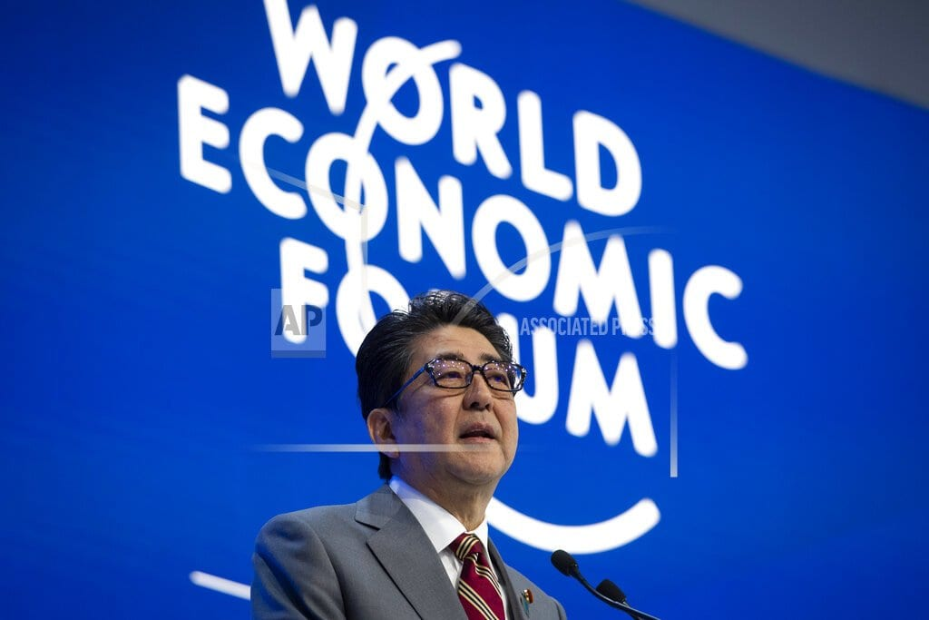 DAVOS, Switzerland | The Latest: Japan's Abe touts trade deals, calls for change
