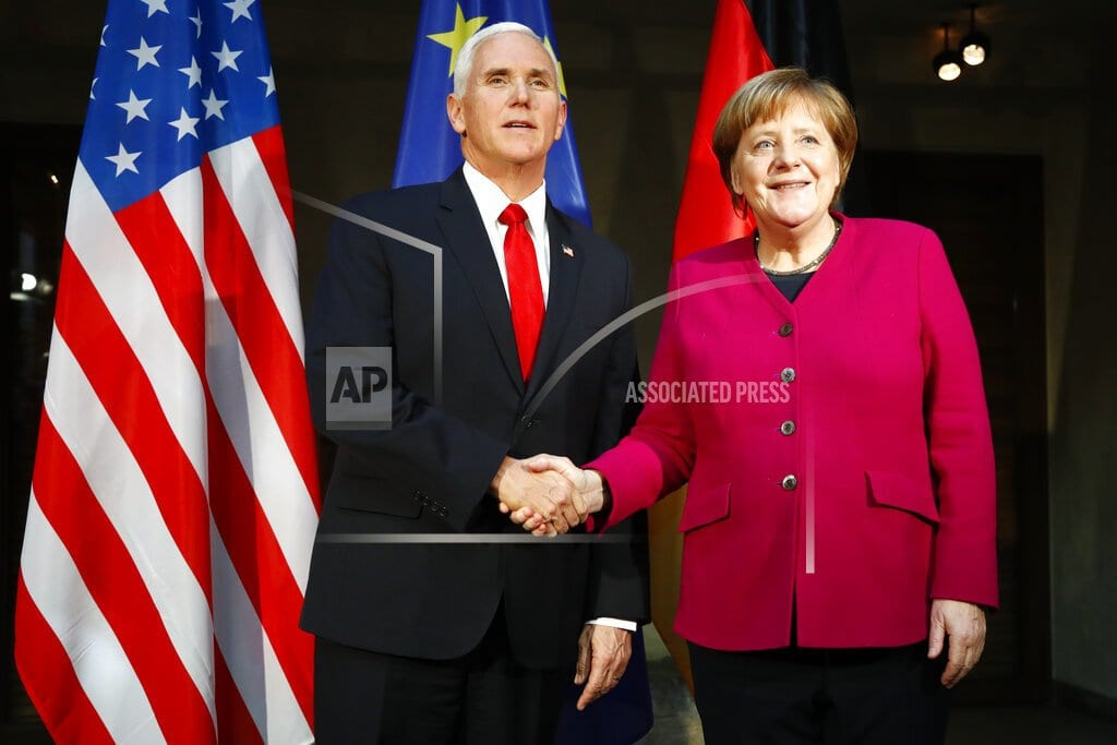 MUNICH | The Latest: Merkel defends Iran deal; Pence blasts Europe