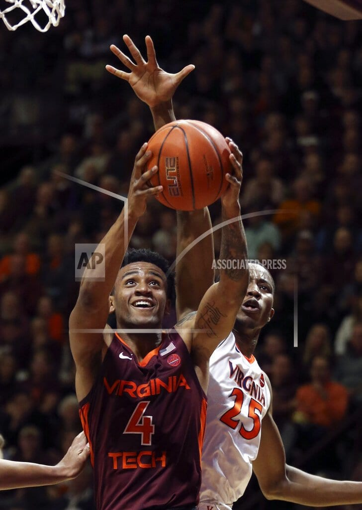 BLACKSBURG, Va | Guy's 23 lift No. 3 Virginia past No. 20 Hokies, 64-58
