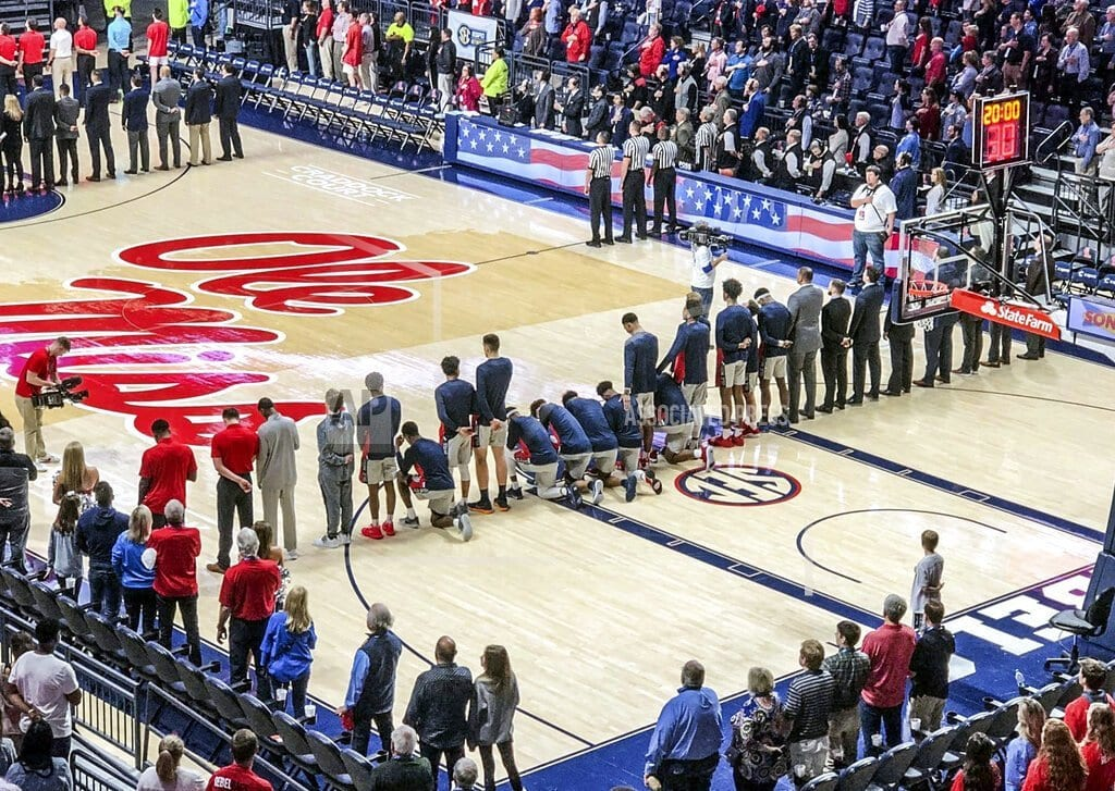 OXFORD, Miss. | Mississippi players kneel during anthem in response to rally